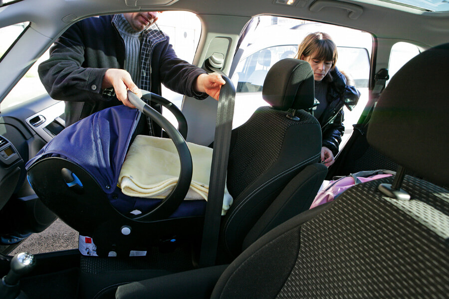 put sheets under a car seat for easy clean up