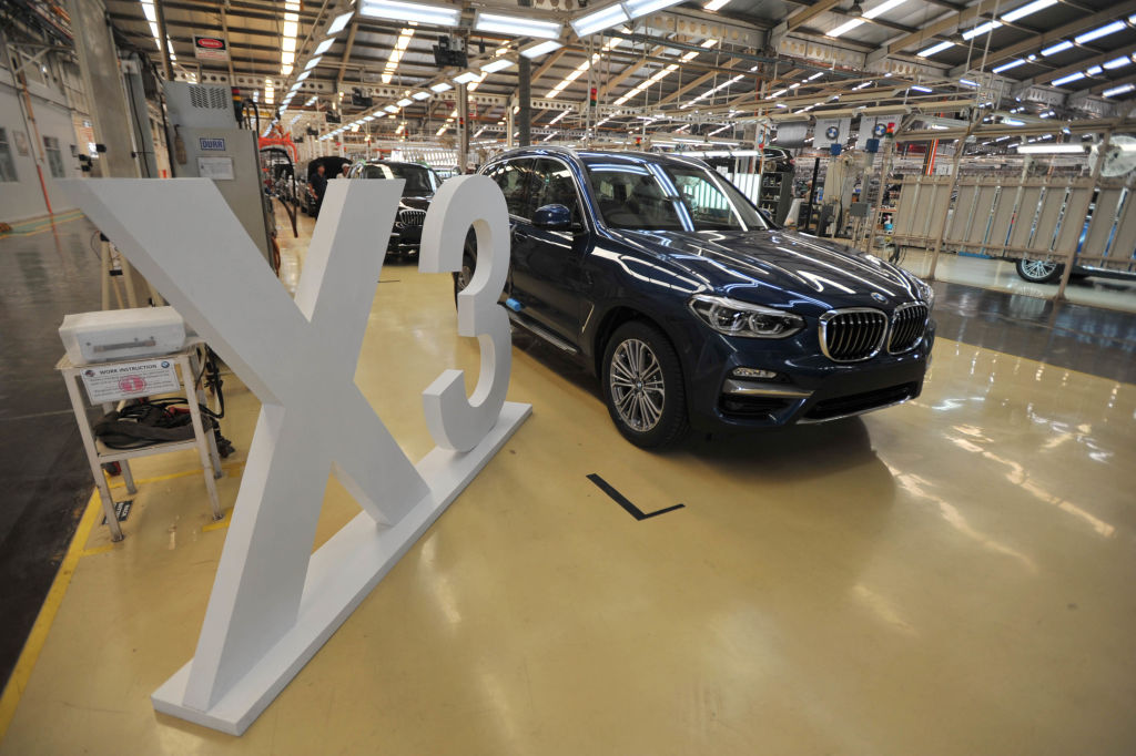 Workers assembly BMW X3 at PT Gaya Motor manufacture in Jakarta, Indonesia