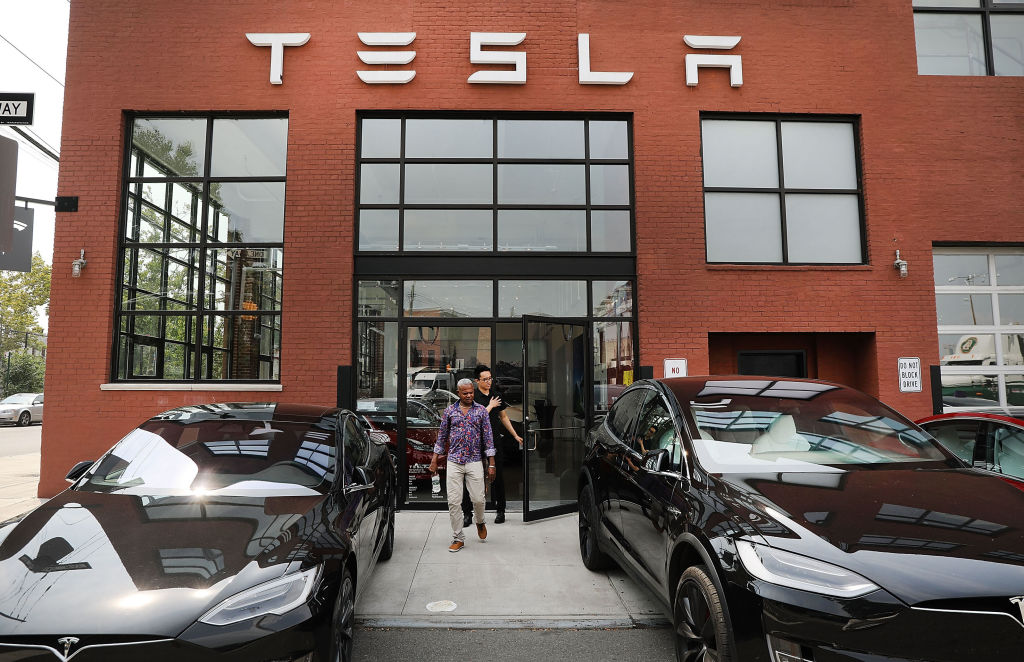 Tesla vehicles stand outside of a Brooklyn showroom and service center