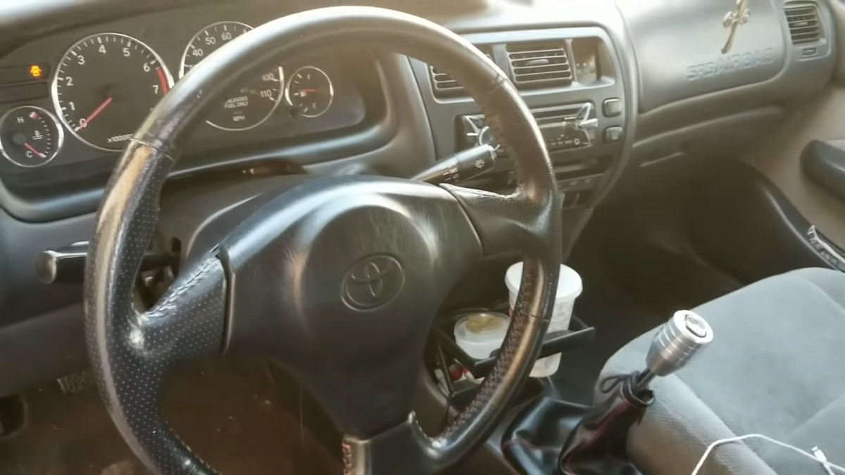 interior of an old toyota corolla