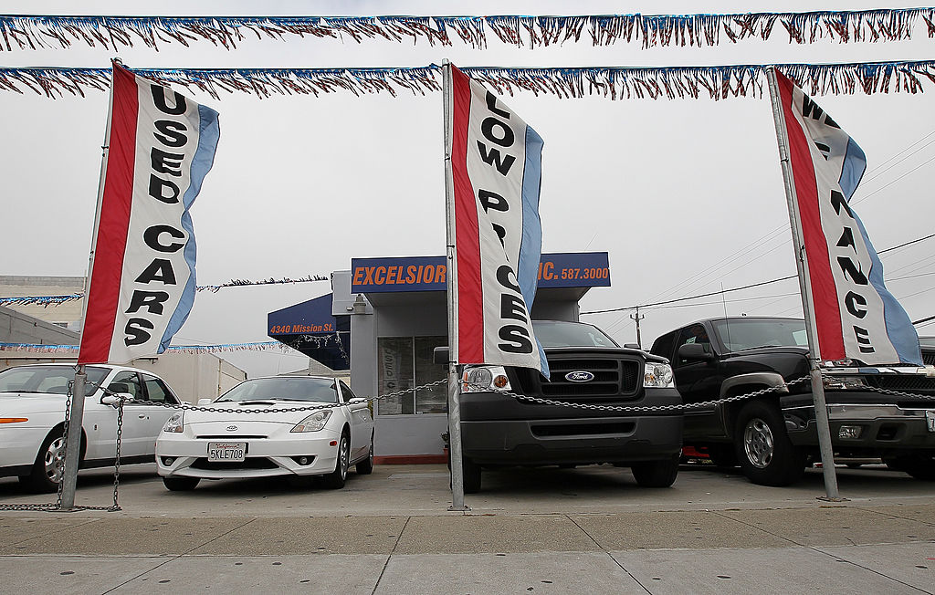 Used cars are displayed on a sales lot