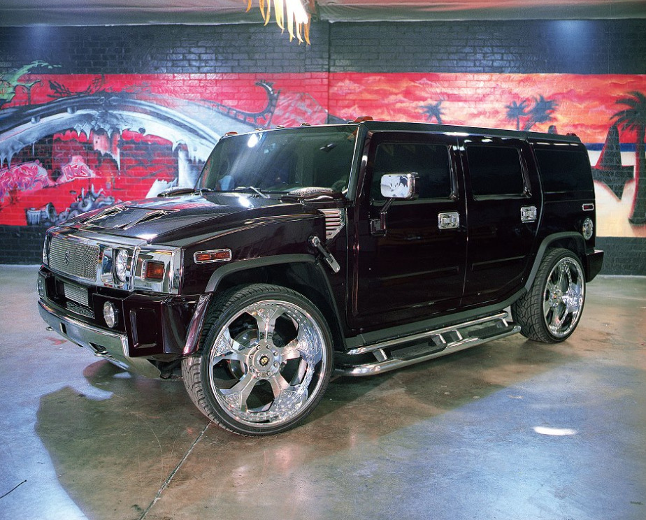 Shaq's hummer sits in a painted parking garage.