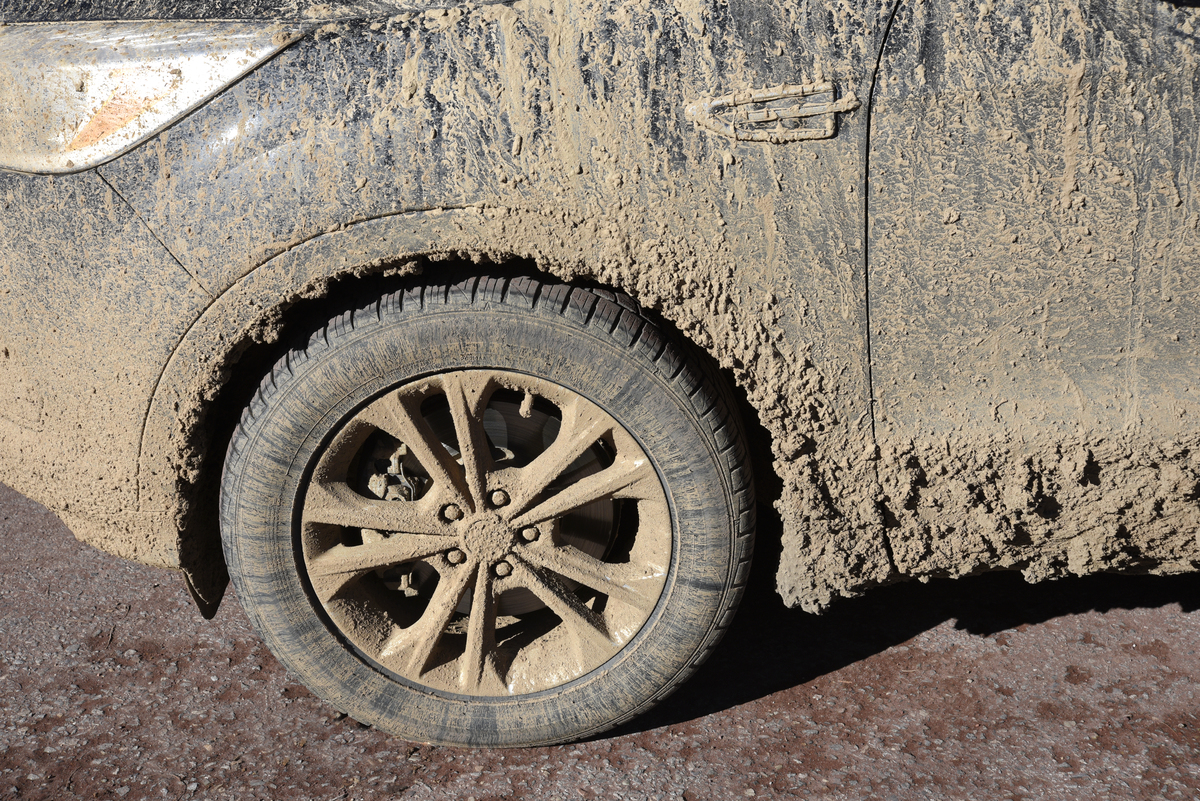 A car covered with mud and dirt