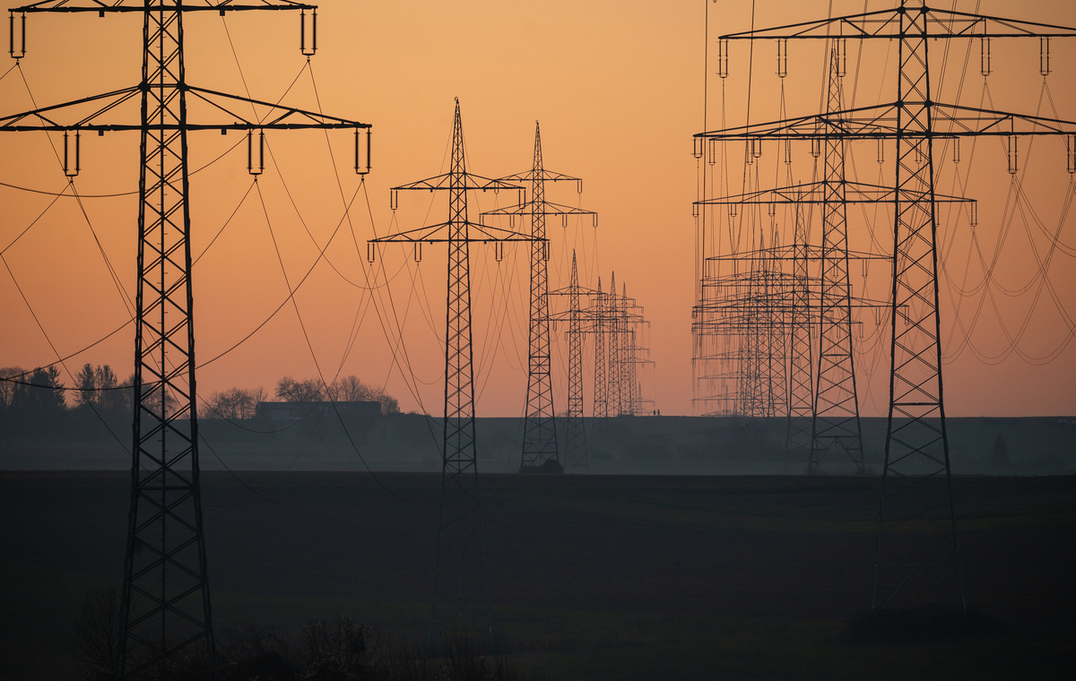 High-voltage lines at sunset