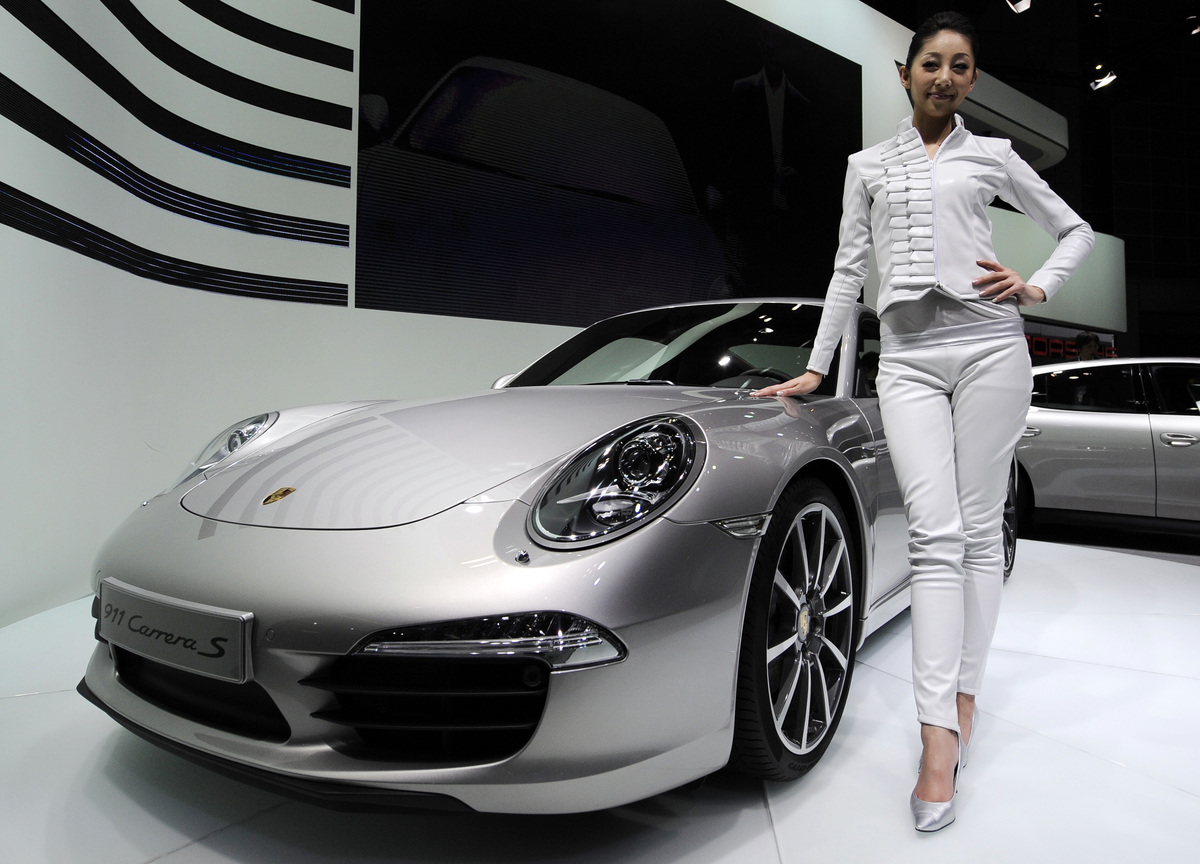 A model poses with Porsche's new 911 Car