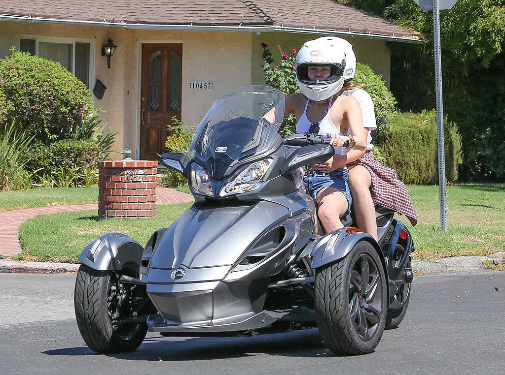Miley on a three-wheel