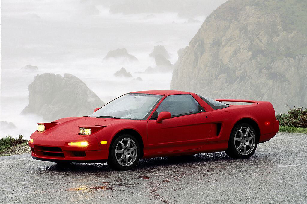 Red NSX with Rocky ocean scenery in background