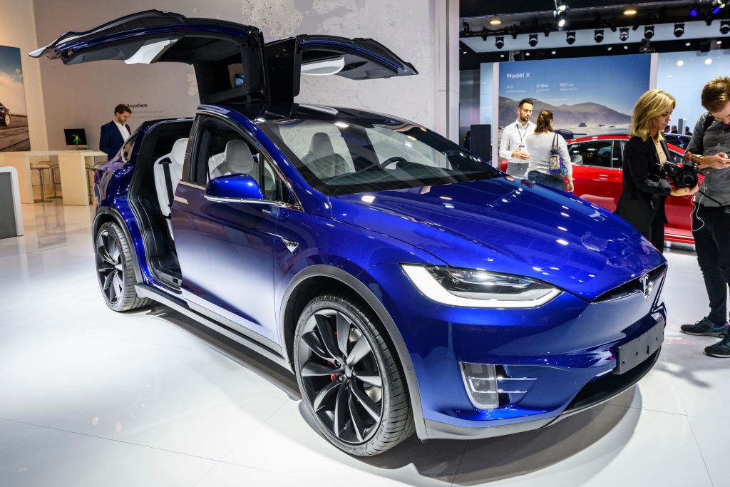 Tesla Model X 90D full electric luxury crossover SUV car on display