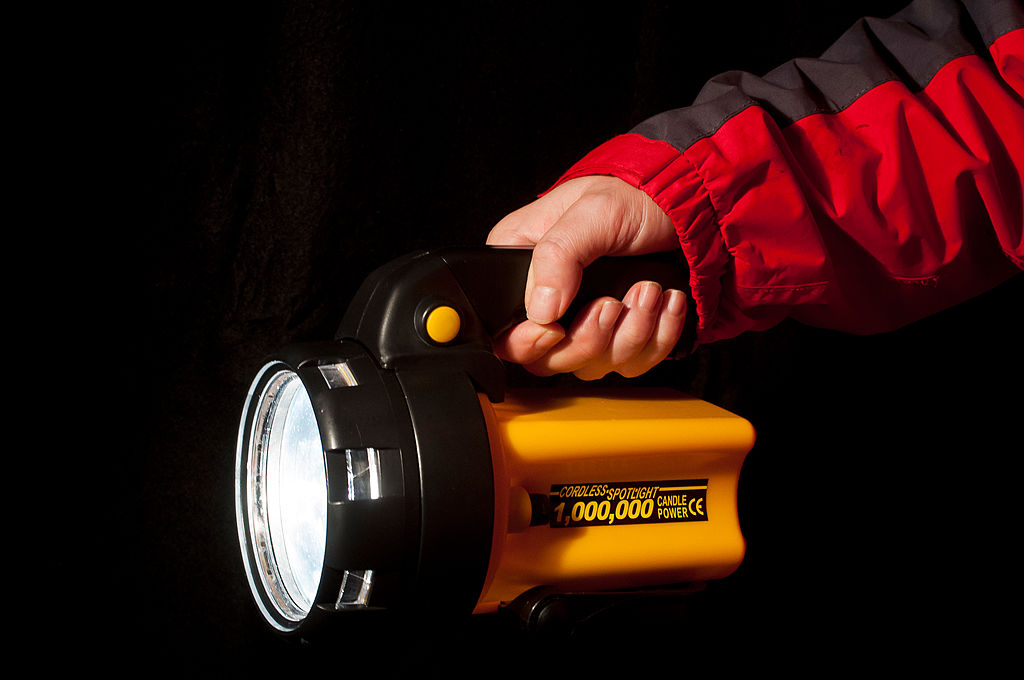 Detail of a photographer holding a Candlepower Spotlight
