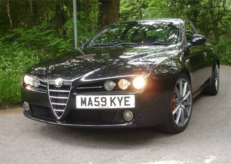 The 2009 Alfa 159 Limited James Bond Edition is pictured in a parking lot.
