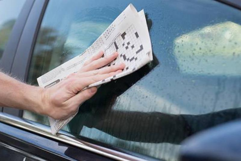 newspaper used to clean outside of car window