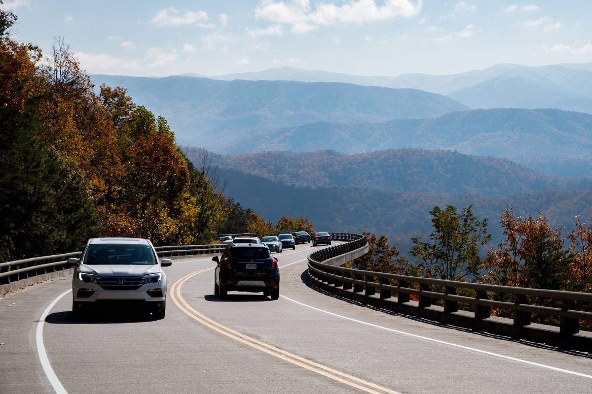 Cars drive through the mountainsides in Tennessee.