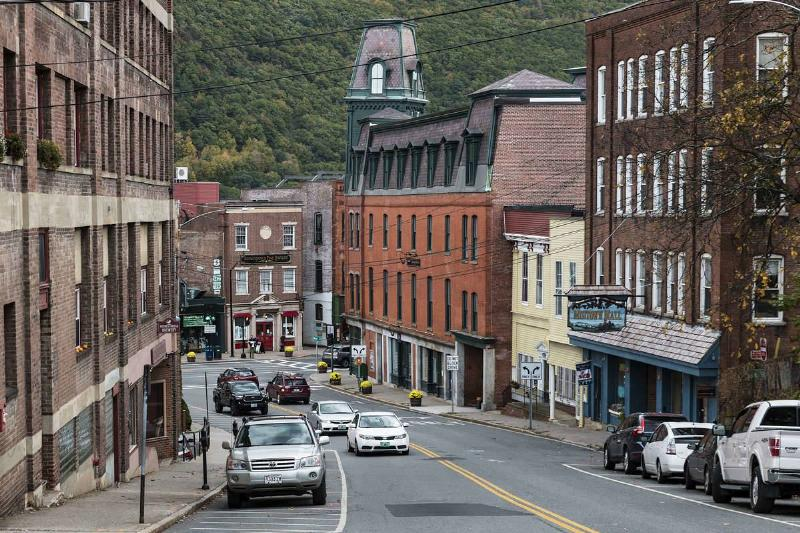 Cars drive down a street in Brattleboro, Vermont.