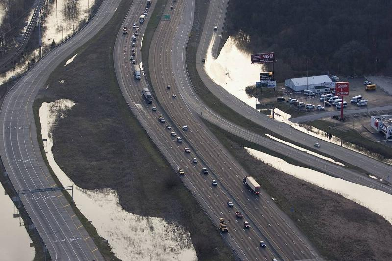 An aerial shows a highway in Missouri after rain.