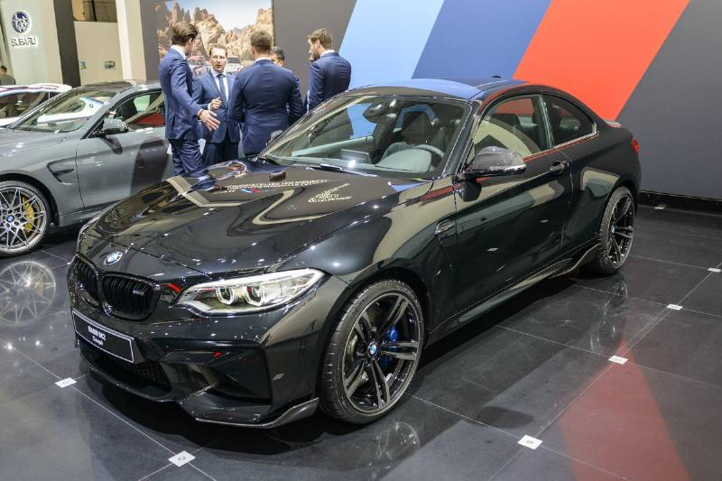 A black 2-Series BMW is for sale.