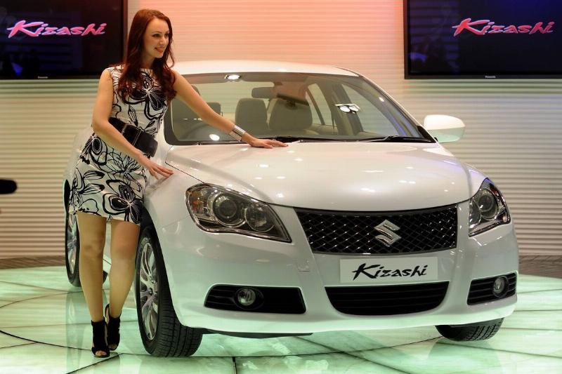 A model poses with the Suzuki Kizashi.