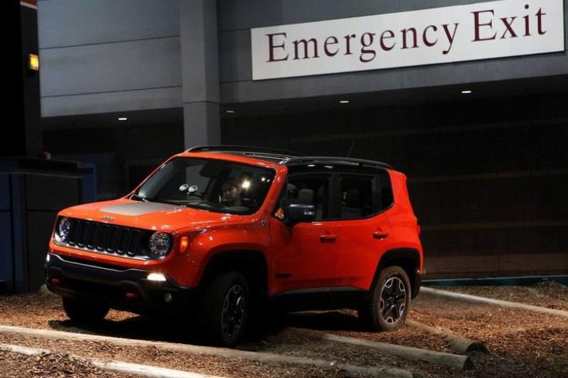 A Jeep Renegade drives outside of an emergency exit.