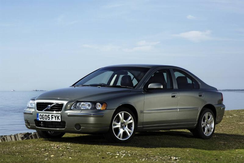 The 2005 Volvo S60 is parked on a cliffside.