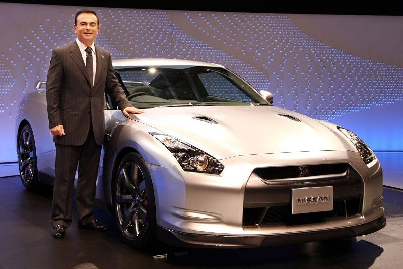 The CEO of Nissan poses next to the GT-R.