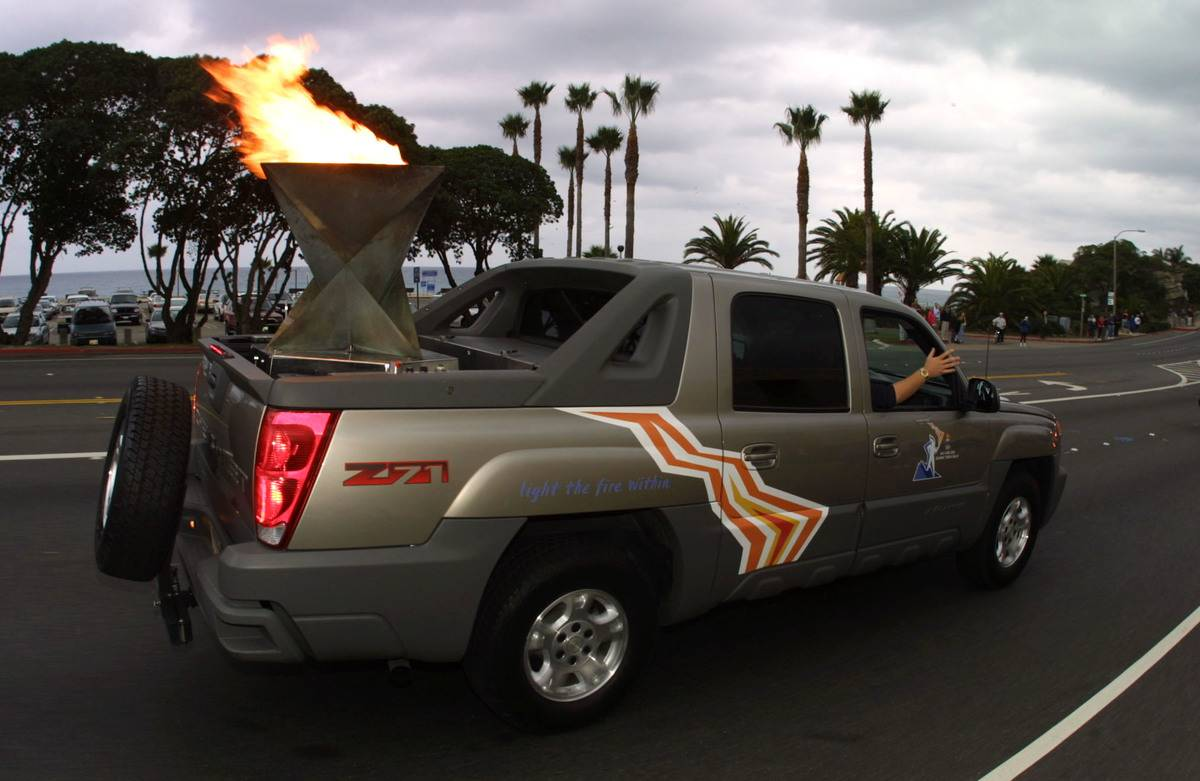 The Olympic Torch gets transported