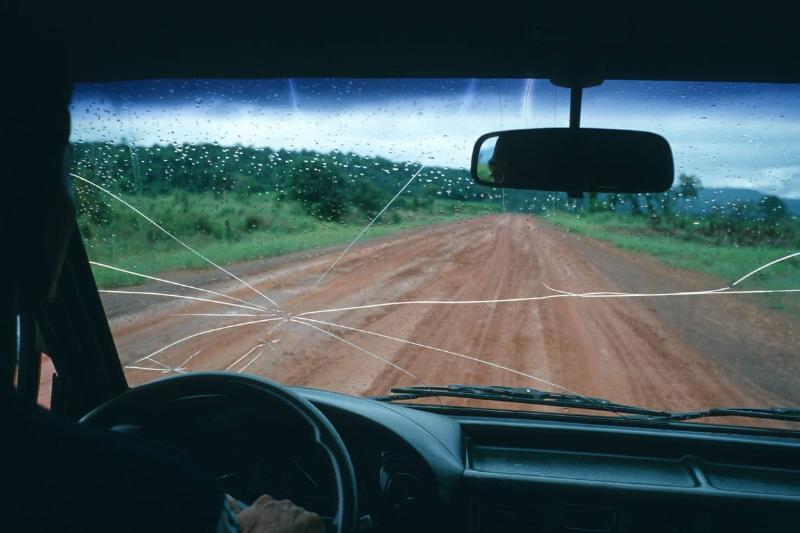 A view through a cracked taxi windscreen on the lonely road...