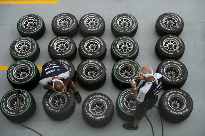 Williams technicians check tyre pressure