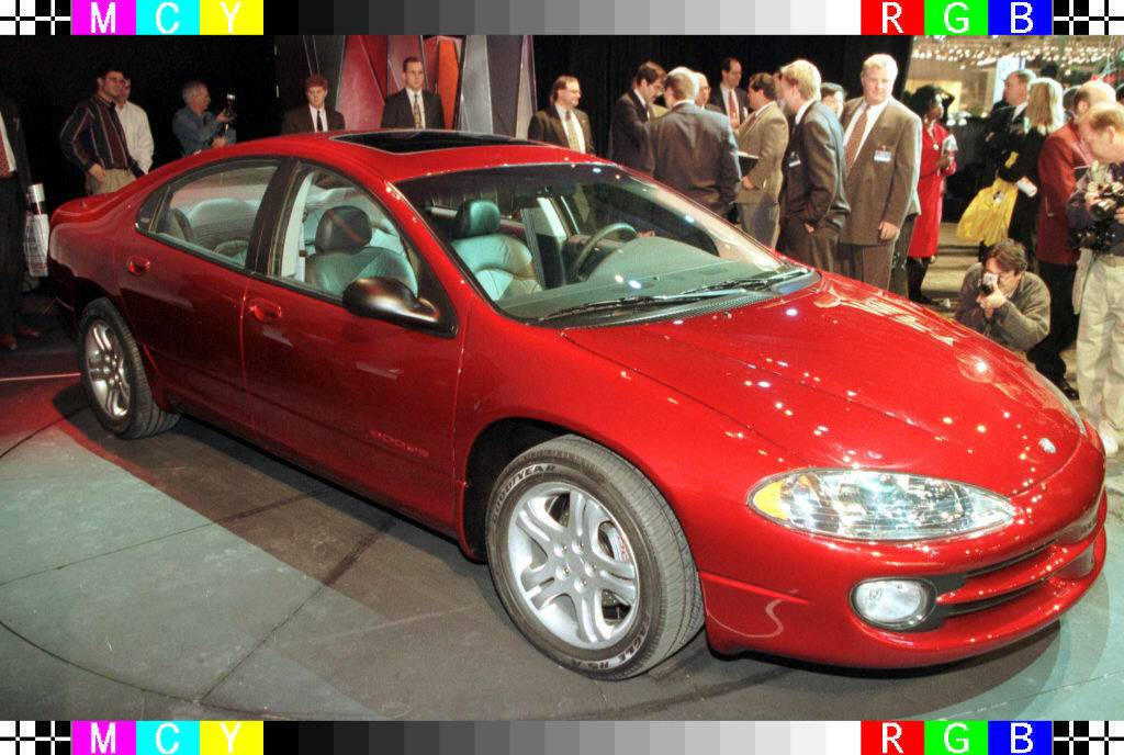 The new 1998 Dodge Intrepid is surrounded by membe