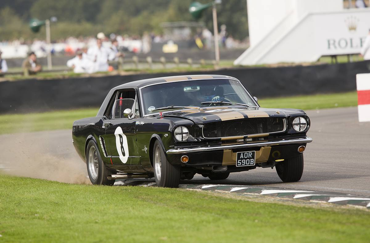 1964 Ford Mustang in The Shelby Cup at the Goodwood Revival Meeting 13th Sept 2014