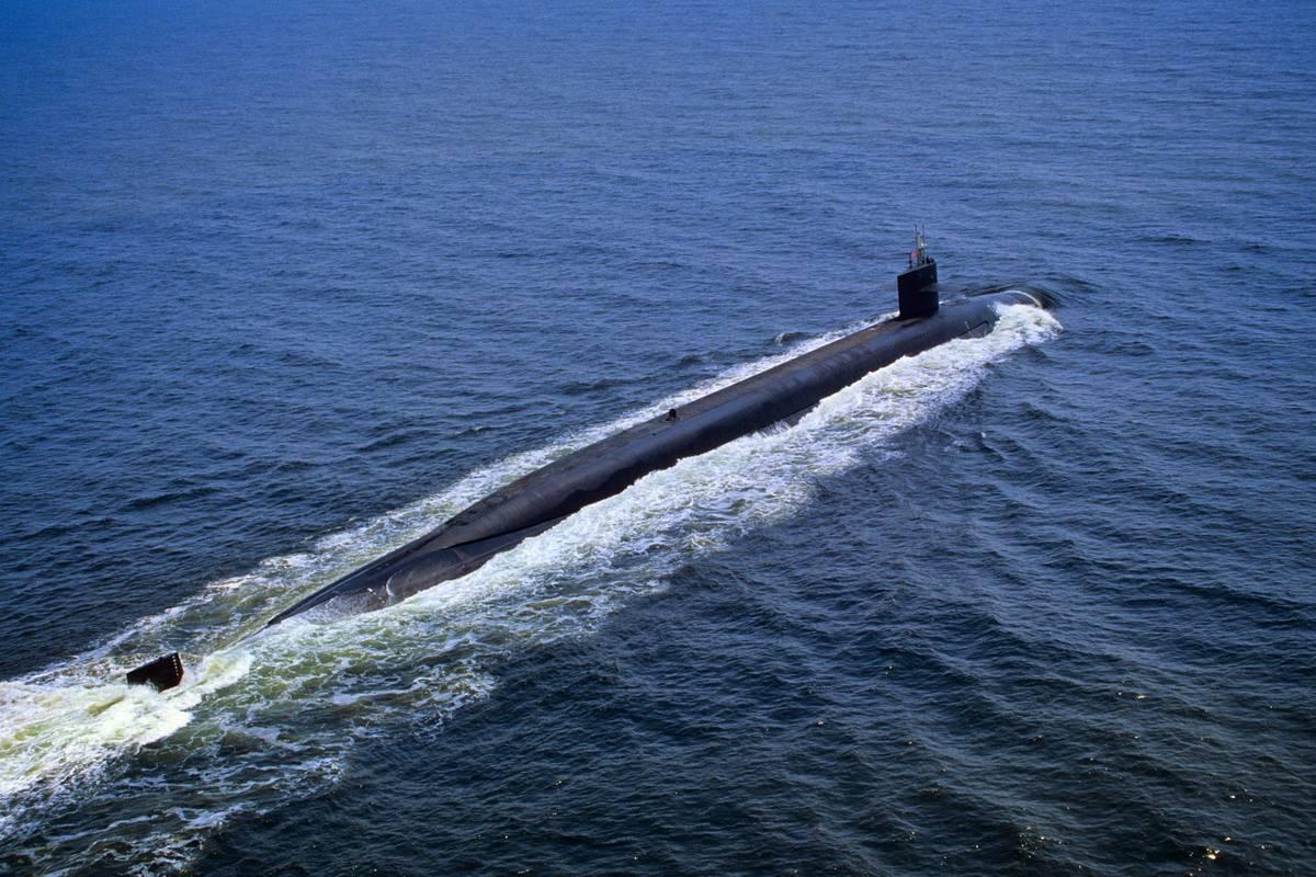 The USS Pennsylvania  Nuclear Powered Ohio-Class Ballistic Missile Submarine cruises across the ocean surface.