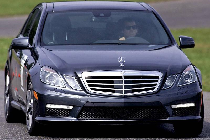 A Mercedes-Benz E63 AMG makes its way around a corner during