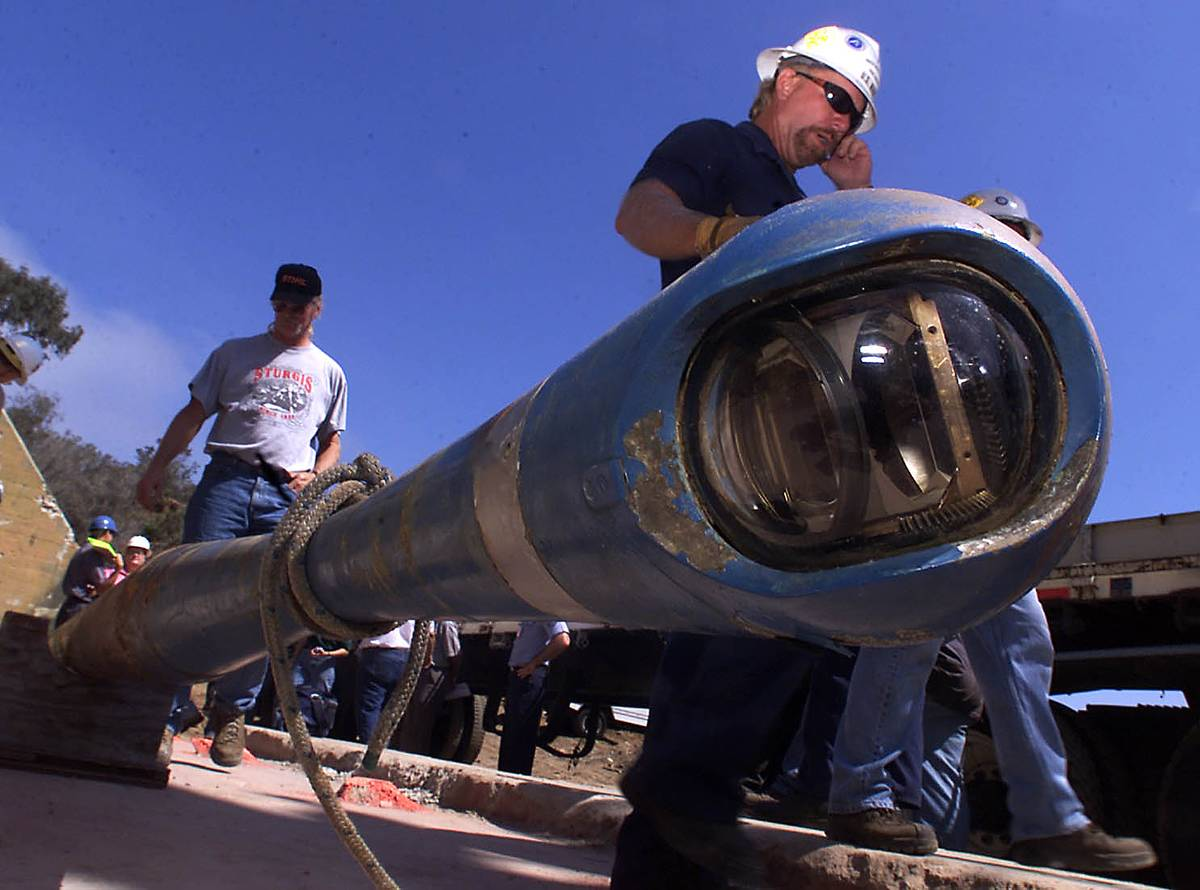 Navy and construction workers develop a periscope.