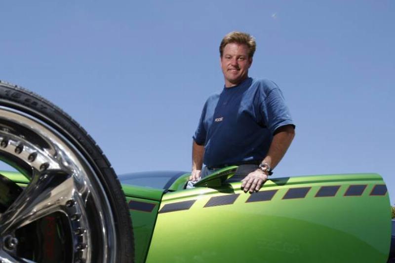 Hot Rod designer Chip Foose stands with his Hemisfear hot rod at his Huntington Beach Foose Design