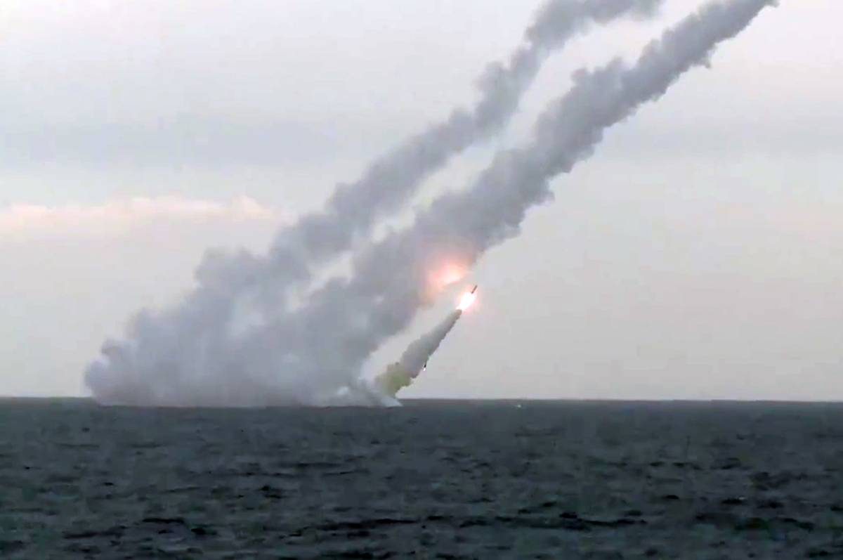 Missiles launch out of a submarine that's underwater.