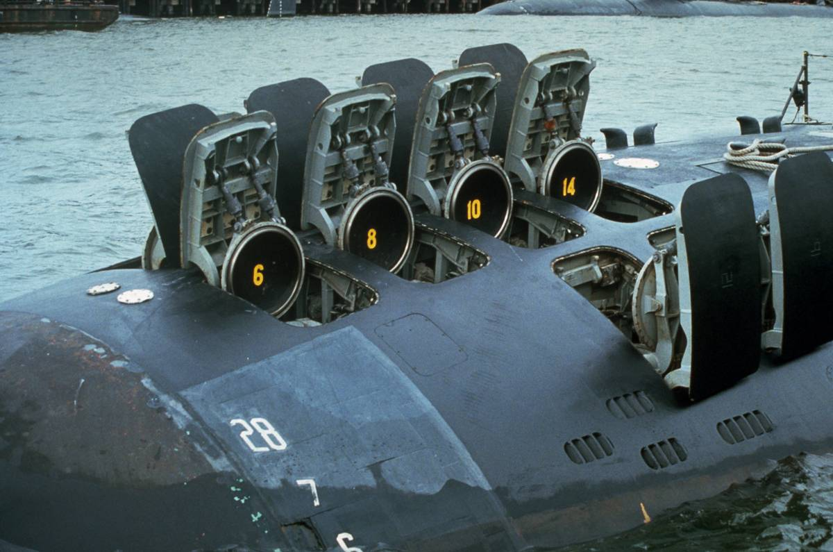 The hatches of 12 Tomahawk missile tubes on a submarine are open.