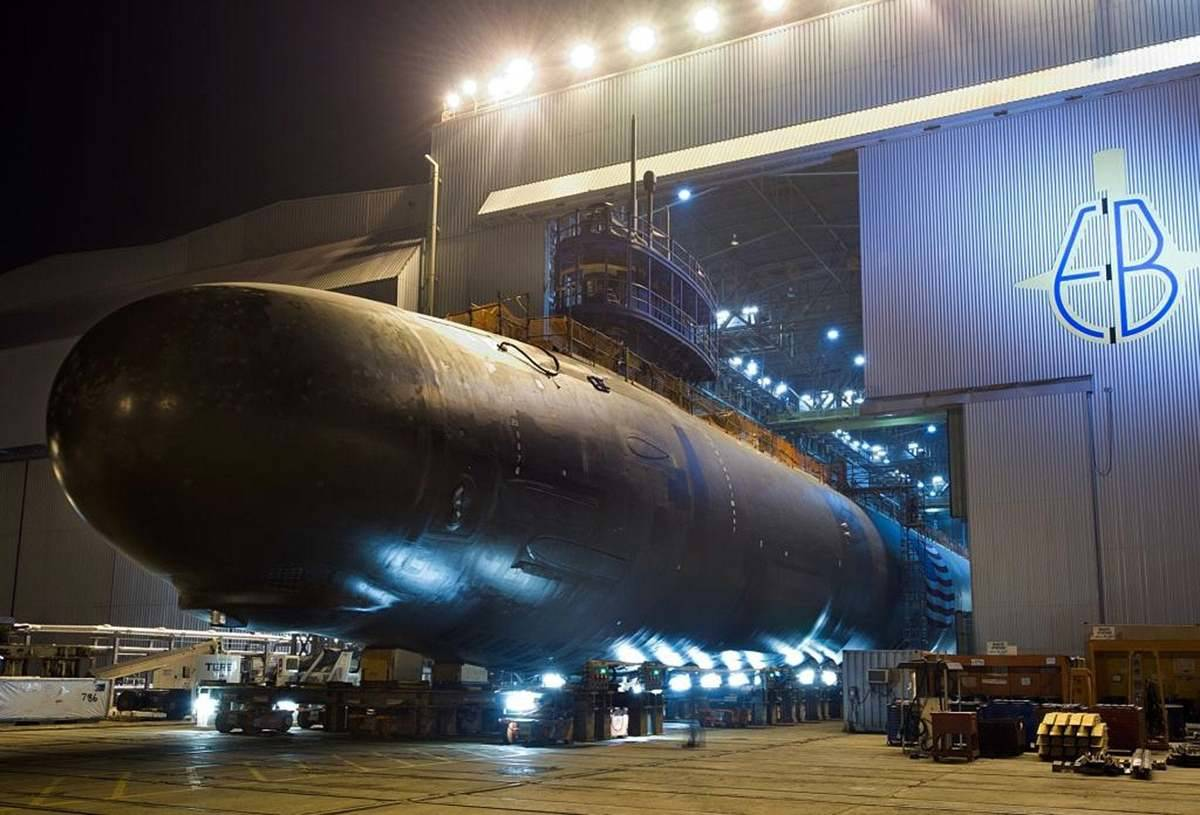 A Virginia-class submarine is being worked on in a Navy dock.