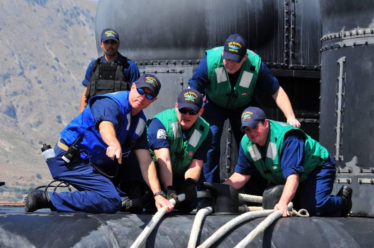 Sailors help work on an Ohio-class submarine.